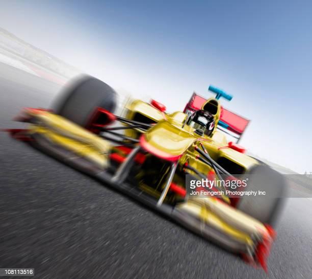 Speeding yellow race car