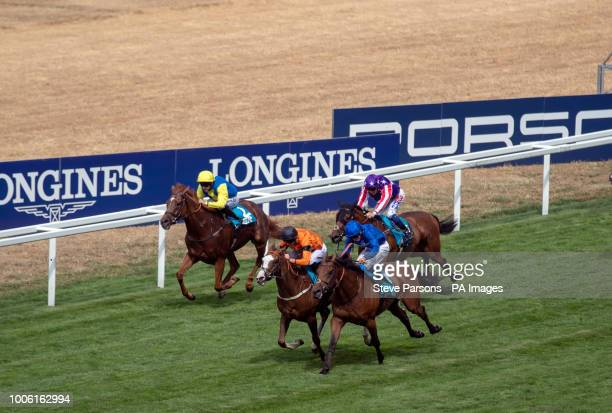 Speedo Boy ridden by James Doyle wins the JGR Brown Jack Handicap from Alqamar ridden by William Buick during Friday of the King George Weekend at...