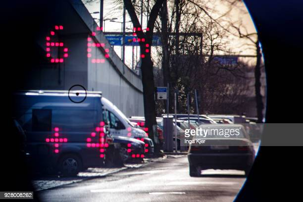 Speedometer of the police measures the speed of road users on February 27, 2018 in Berlin, Germany. The upper value describes the distance and the...