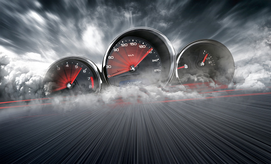 Speedometer scoring high speed in a fast motion blur racetrack background. Speeding Car Background Photo Concept. 1158758743