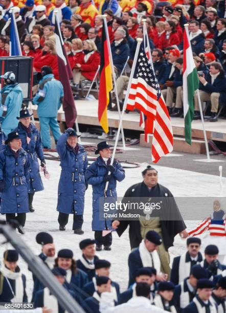 Speedskater Eric Flaim of the United States carries the flag for the USA team during the Opening Ceremonies of the 1998 Winter Olympic Games on...