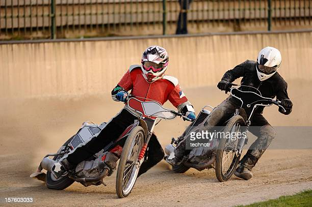 speedway racers compeeting - motor racing track stock pictures, royalty-free photos & images