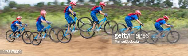 speedy 7 year old riding a mountain bike - sequential series stock pictures, royalty-free photos & images