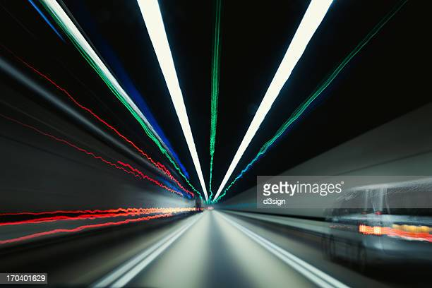 Speedy car driving in tunnel