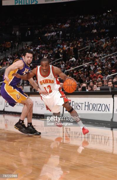 Speedy Claxton of the Atlanta Hawks drives to the basket against Jordan Farmar of the Los Angeles Lakers at Philips Arena February 5 2007 in Atlanta...
