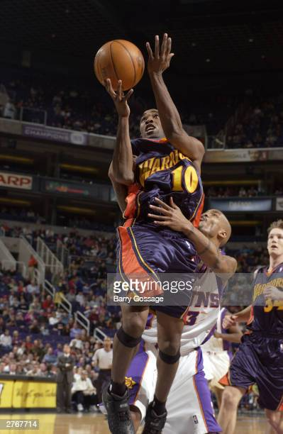 Speedy Claxton of the Golden State Warriors shoots against the Phoenix Suns at America West Arena on November 28 2003 in Phoenix Arizona NOTE TO USER...