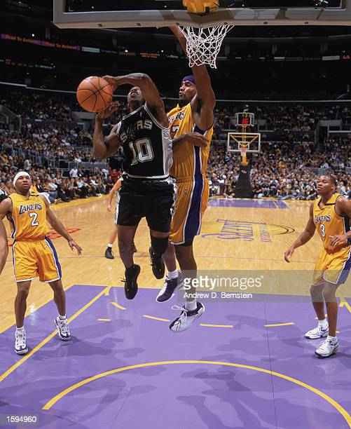 Speedy Claxton of the San Antonio Spurs shoots over Samaki Walker of the Los Angeles Lakers during the NBA game at Staples Center on October 29 2002...