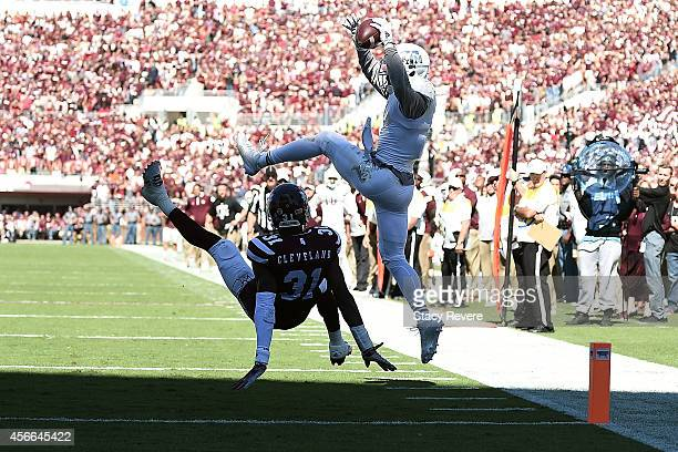 Speedy Noil of the Texas AM Aggies catches a touchdown pass in front of Tolando Cleveland of the Mississippi State Bulldogs during the third quarter...