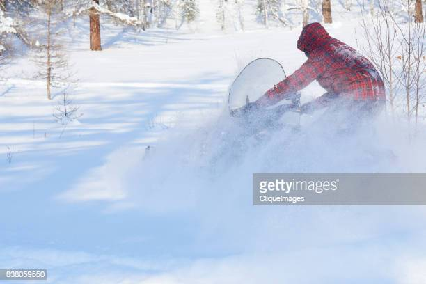 speedy snowmobile ride on field - cliqueimages stock pictures, royalty-free photos & images