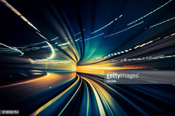 speedy train, blurred motion - illuminated stock pictures, royalty-free photos & images