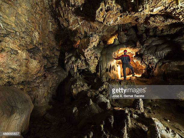speleologist investigating a cave - speleology stock pictures, royalty-free photos & images