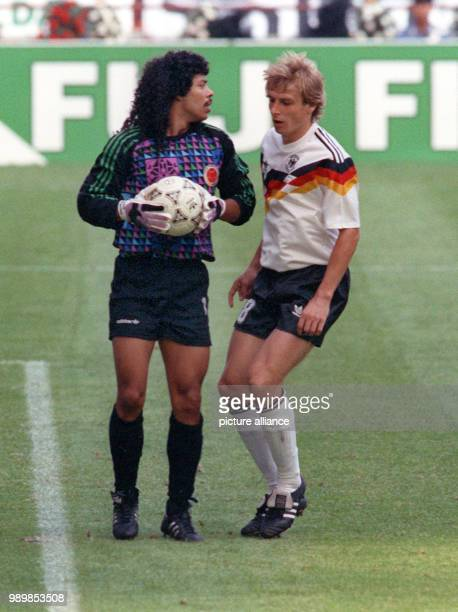 Spellbound German striker Juergen Klinsmann stares at the ball that is held provocatively long by Colombian's goalkeeper The match ends with a 11 tie...