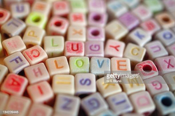 'LOVE' spelled out with colorful dices