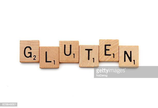 GLUTEN spelled out with Scrabble letter tiles