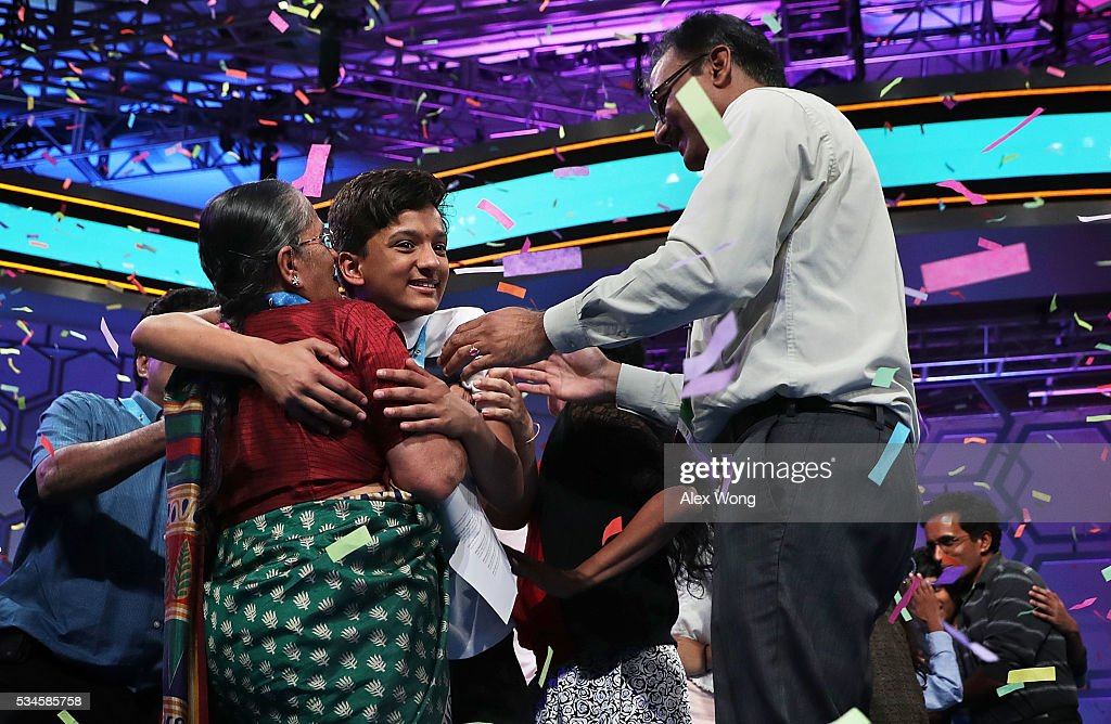 Speller Jairam Jagadeesh Hathwar (C) of Painted Post, New York, celebrates with family members after the finals of the 2016 Scripps National Spelling Bee May 26, 2016 in National Harbor, Maryland. Both spellers were declared co-champions at the end of the annual spelling competition.