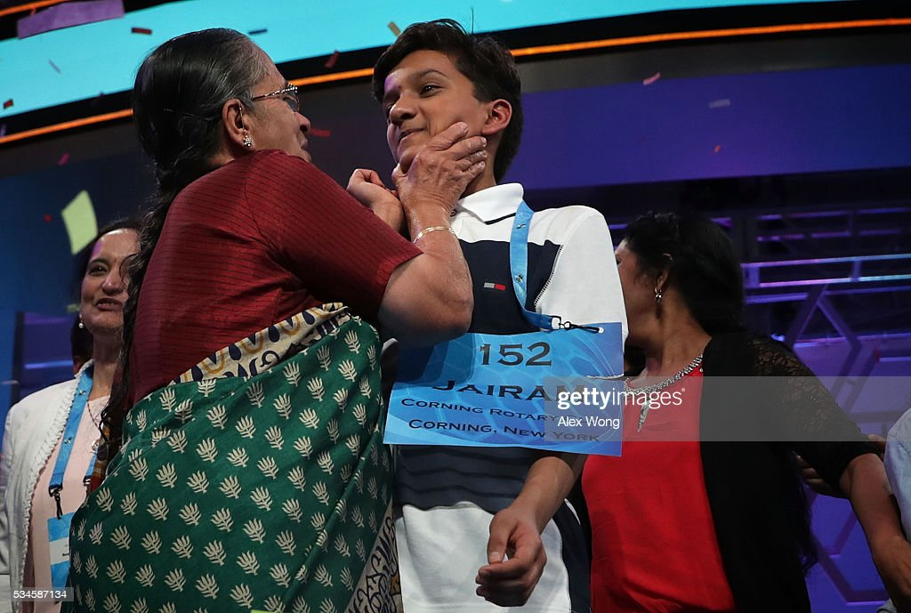Speller Jairam Jagadeesh Hathwar (R) of Painted Post, New York is greeted by a family member after the finals of the 2016 Scripps National Spelling Bee May 26, 2016 in National Harbor, Maryland. Both spellers were declared co-champions at the end of the annual spelling competition.