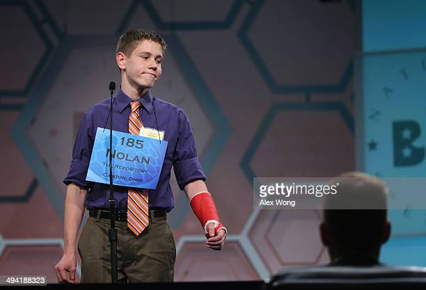 Speller Nolan Reed of New Philadelphia Ohio reacts after he misspelled his word during round three of the 2014 Scripps National Spelling Bee...