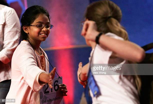 Spellers Anahita Kalra Iyer of Doylestown Pennsylvania extends her hand for a hifive with Cheyenne Lawrence of Silver Springs Nevada during the oral...