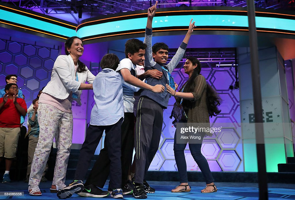 Spellers Nihar Saireddy Janga (2nd R) of Austin, Texas and Jairam Jagadeesh Hathwar (3rd L) of Painted Post, New York celebrate with family members after the finals of the 2016 Scripps National Spelling Bee May 26, 2016 in National Harbor, Maryland. Both spellers were declared co-champions at the end of the annual spelling competition.