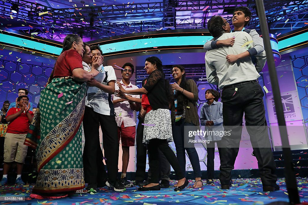 Spellers Nihar Saireddy Janga (R) of Austin, Texas and Jairam Jagadeesh Hathwar (3rd L) of Painted Post, New York celebrate with family members after the finals of the 2016 Scripps National Spelling Bee May 26, 2016 in National Harbor, Maryland. Both spellers were declared co-champions at the end of the annual spelling competition.
