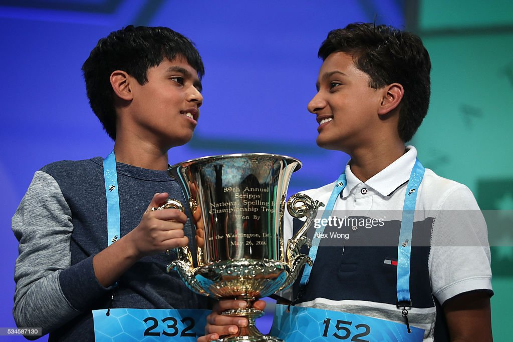 Spellers Nihar Saireddy Janga (L) of Austin, Texas and Jairam Jagadeesh Hathwar (R) of Painted Post, New York hold a trophy after the finals of the 2016 Scripps National Spelling Bee May 26, 2016 in National Harbor, Maryland. Both spellers were declared co-champions at the end of the annual spelling competition.