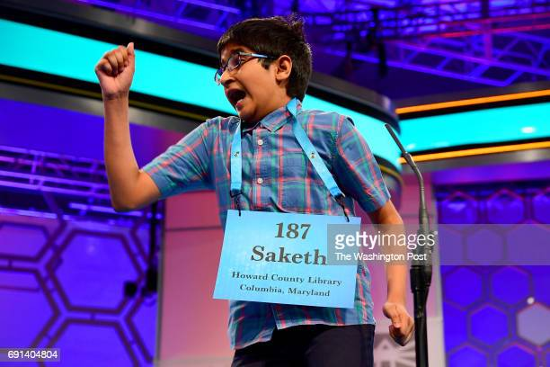 Spelling bee contestant Saketh Sundar from Elkridge Md reacts after correctly spelling a word during the morning session of the 90th Scripps National...