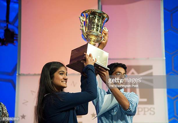 Spelling Bee contestants Vanya Shivashankar of Olathe KS and Gokul Venkatachalam of Chesterfield MO cochampions hoist the trophy during the final...