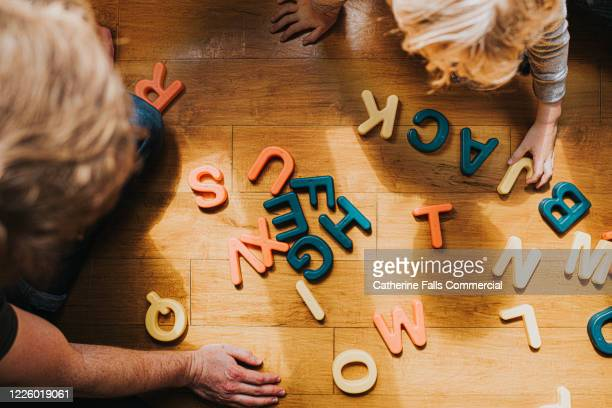 spelling - genderblend stock pictures, royalty-free photos & images