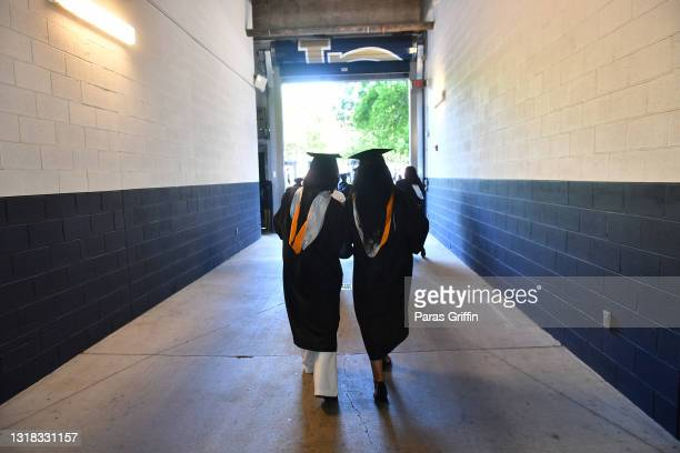 Spelman College graduates walking during the 2020 & 2021 Spelman College Commencement at Bobby Dodd Stadium on May 16, 2021 in Atlanta, Georgia....