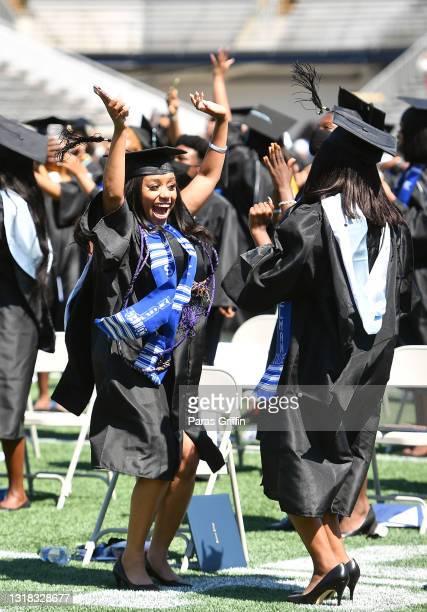 Spelman graduates celebrate during 2020 & 2021 Spelman College Commencement at Bobby Dodd Stadium on May 16, 2021 in Atlanta, Georgia. Spelman...