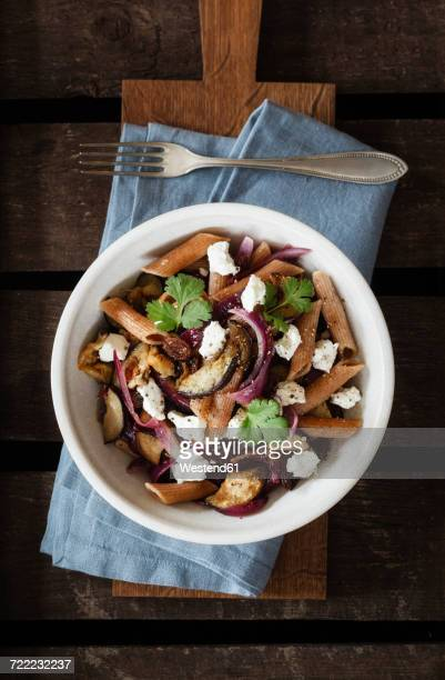 Spelt rigatoni with aubergines, feta and raisins