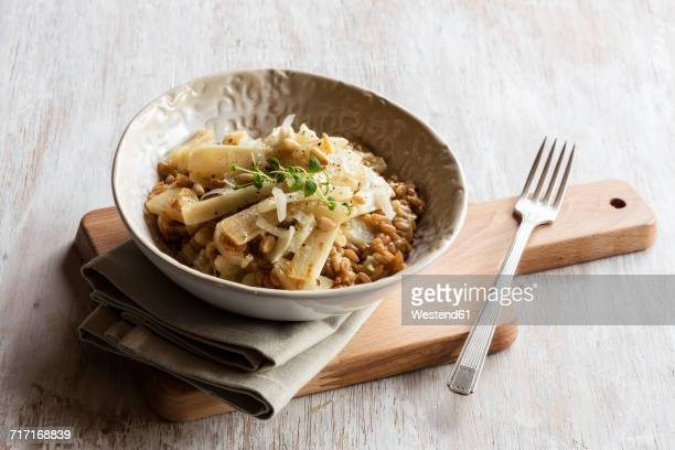 Spelt risotto with salsifies, pine nuts and parmesan
