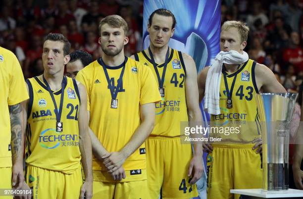 Spencer Butterfield Hendrik Drescher Dennis Clifford and Luke Sikma of Alba Berlin react after loosing the fifth and final playoff game of the German...