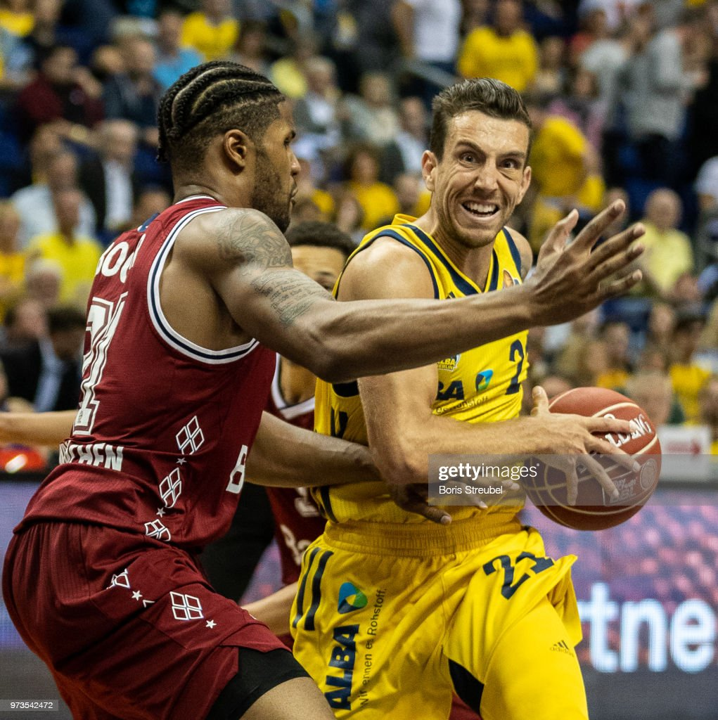 Spencer Butterfield of ALBA Berlin competes with Devin Booker Bayern Muenchen during the fourth play-off game of the German Basketball Bundesliga finals at Mercedes-Benz Arena on June 13, 2018 in Berlin, Germany.