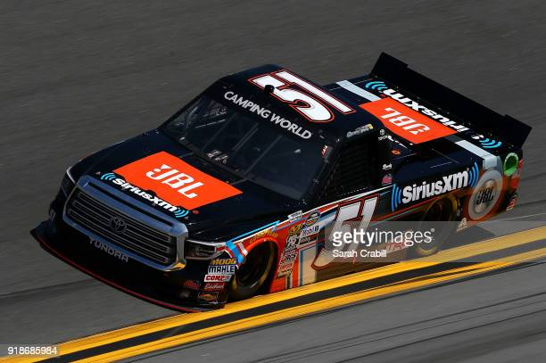 Spencer Davis driver of the JBL/Sirius XM Toyota practices for the NASCAR Camping World Truck Series NextEra Energy Resources 250 at Daytona...