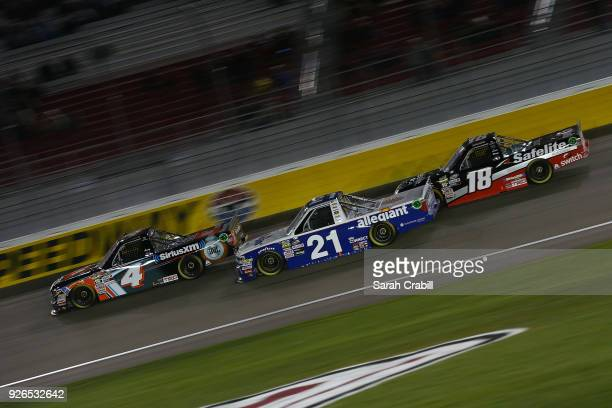 Spencer Davis driver of the JBL/SiriusXM Toyota leads Johnny Sauter driver of the Allegiant Airlines Chevrolet and Noah Gragson driver of the...