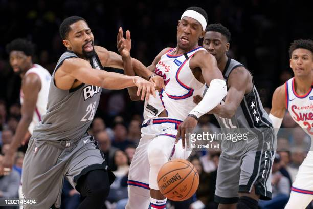 Spencer Dinwiddie and Caris LeVert of the Brooklyn Nets battle for the ball against Josh Richardson of the Philadelphia 76ers in the fourth quarter...