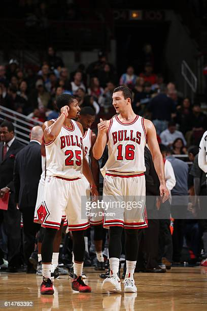 Spencer Dinwiddie and Paul Zipser of the Chicago Bulls talk during the game against the Cleveland Cavaliers on October 14 2016 at the United Center...