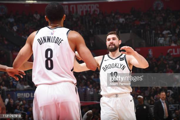 Spencer Dinwiddie celebrates with Joe Harris of the Brooklyn Nets during the game against the LA Clippers on March 17 2019 at STAPLES Center in Los...