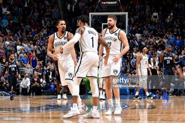 Spencer Dinwiddie D'Angelo Russell and Joe Harris of the Brooklyn Nets react to a plau during the game against the Orlando Magic on January 18 2019...