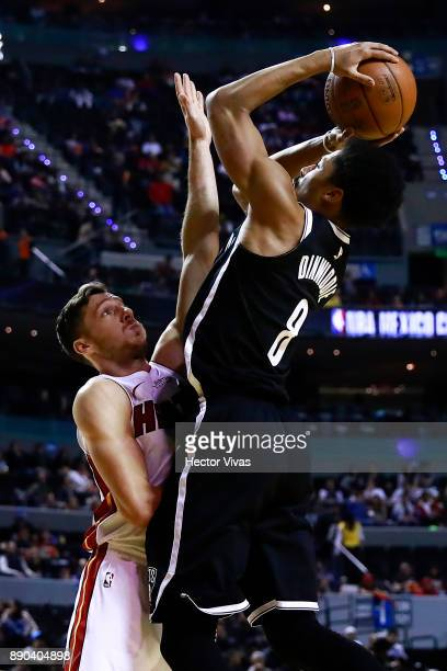 Spencer Dinwiddie of Brooklyn Nets shoots the ball against Goran Dragic of Miami Heat during the NBA game between the Brooklyn Nets and Miami Heat at...