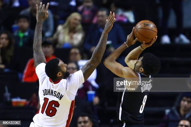 Spencer Dinwiddie of Brooklyn Nets shots the ball against James Johnson of Miami Heat during the NBA game between the Brooklyn Nets and Miami Heat at...