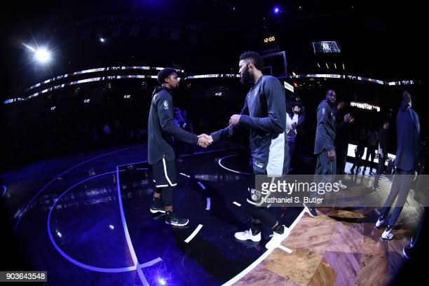 Spencer Dinwiddie of the Brooklyn Nets and Allen Crabbe of the Brooklyn Nets greet each other before the game against the Detroit Pistons on January...