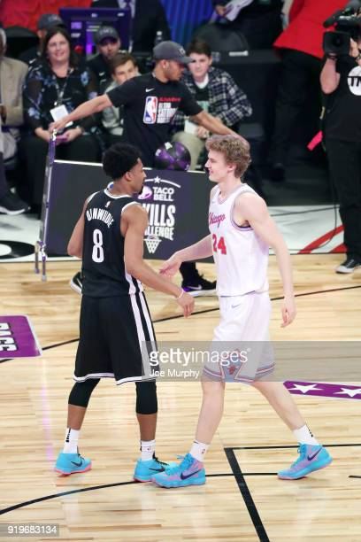 Spencer Dinwiddie of the Brooklyn Nets and Lauri Markkanen of the Chicago Bulls hug during the Taco Bell Skills Challenge during State Farm AllStar...