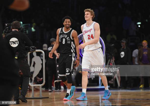 Spencer Dinwiddie of the Brooklyn Nets and Lauri Markkanen of the Chicago Bulls walk off the court after competing in the 2018 Taco Bell Skills...