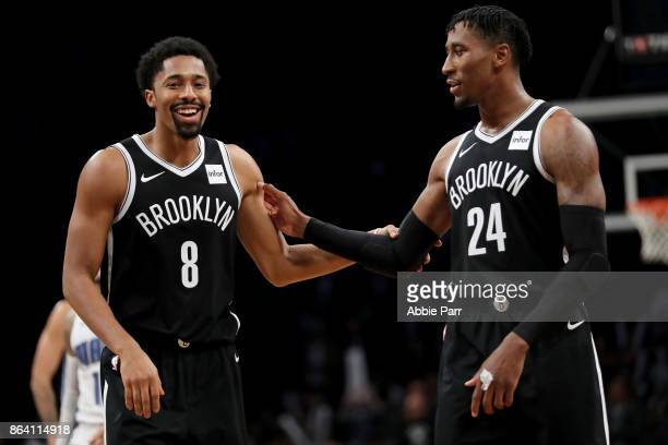 Spencer Dinwiddie of the Brooklyn Nets and Rondae HollisJefferson celebrate the Nets' 126121 win over the Orlando Magic during their game at Barclays...
