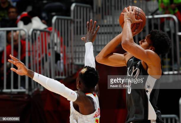 Spencer Dinwiddie of the Brooklyn Nets attempts a shot against Dennis Schroder of the Atlanta Hawks at Philips Arena on January 12 2018 in Atlanta...