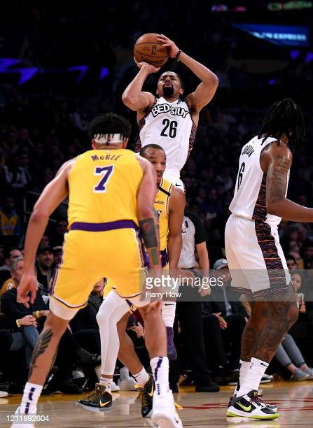 Spencer Dinwiddie of the Brooklyn Nets attempts a shot in front of Avery Bradley and JaVale McGee of the Los Angeles Lakers during the first half at...