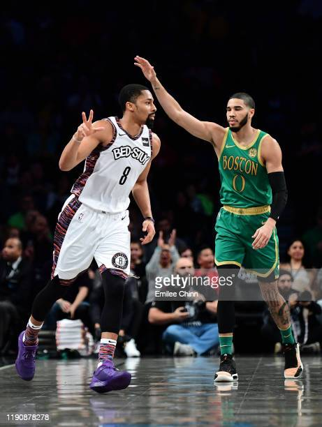 Spencer Dinwiddie of the Brooklyn Nets celebrates after a three pointer as Jayson Tatum of the Boston Celtics reacts during in the first half of...