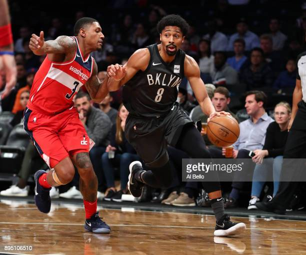 Spencer Dinwiddie of the Brooklyn Nets dribbles against Bradley Beal of the Washington Wizards during their game at Barclays Center on December 12...